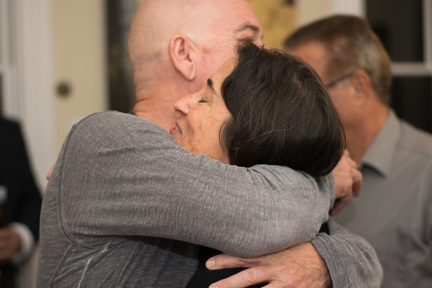 Thomas hugs Julie as they celebrate the success of the gallery opening.