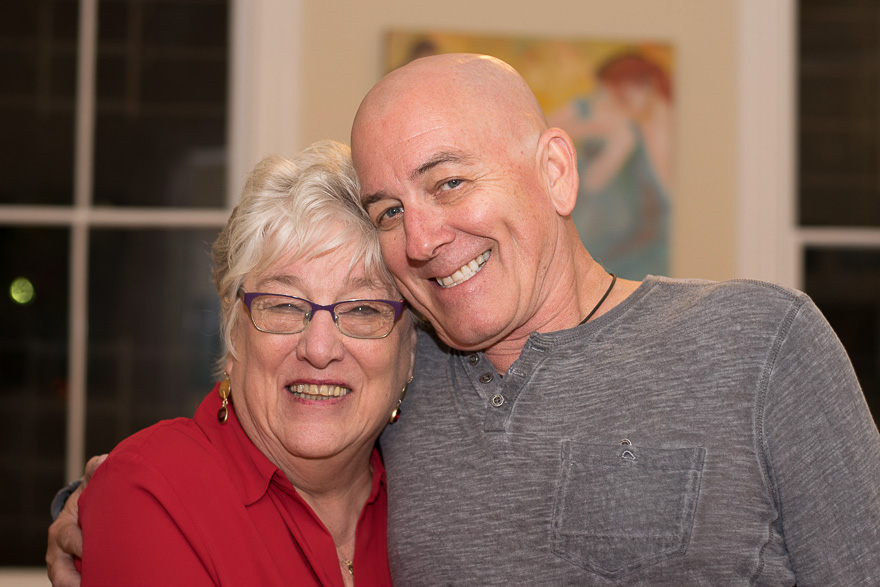 Mary Ann and Thomas hug and smile for the camera near the end fo the gallery opening!