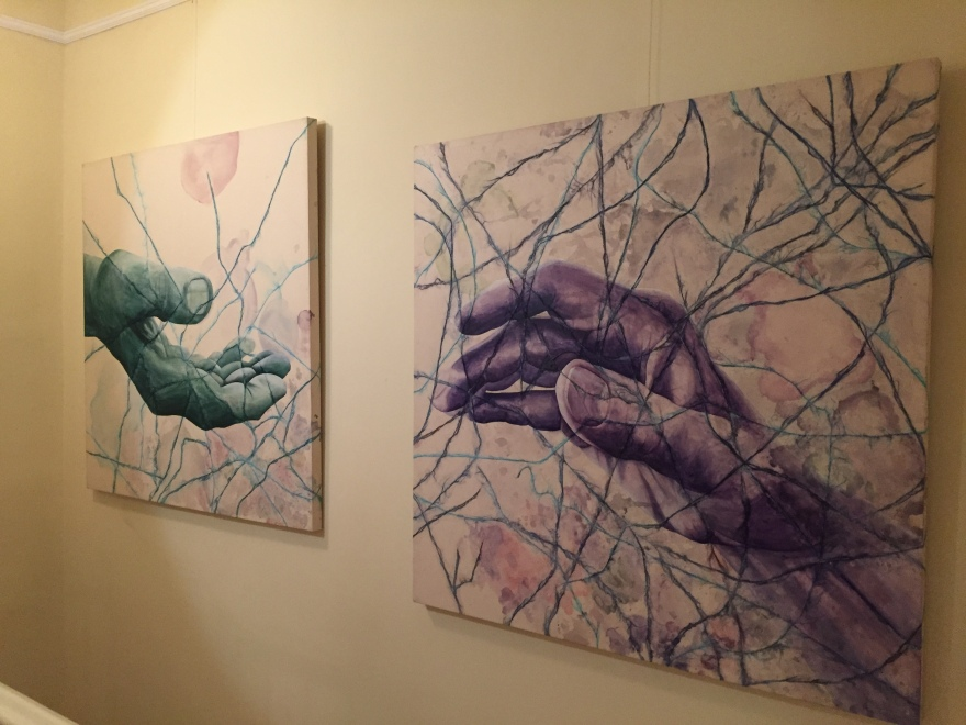 A diptych of two paintings depict two hands that convey Alzheimer's and the separation it puts between those that we love.