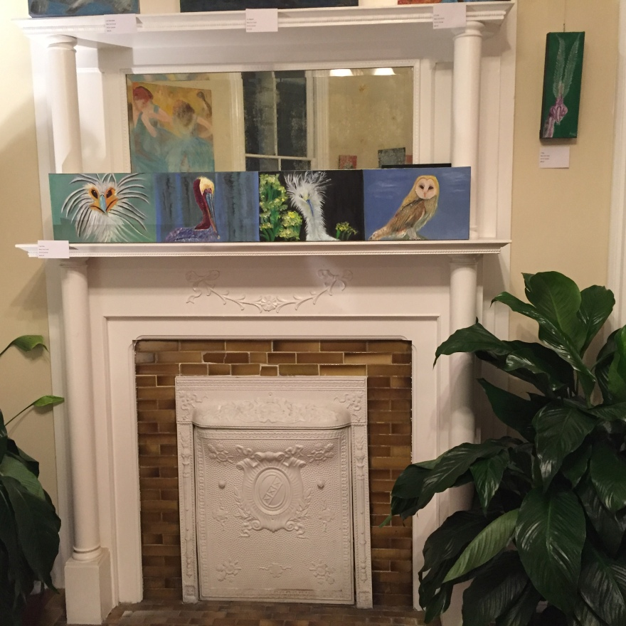 Colorful paintings of Mary Ann's are displayed on the fireplace mantel.