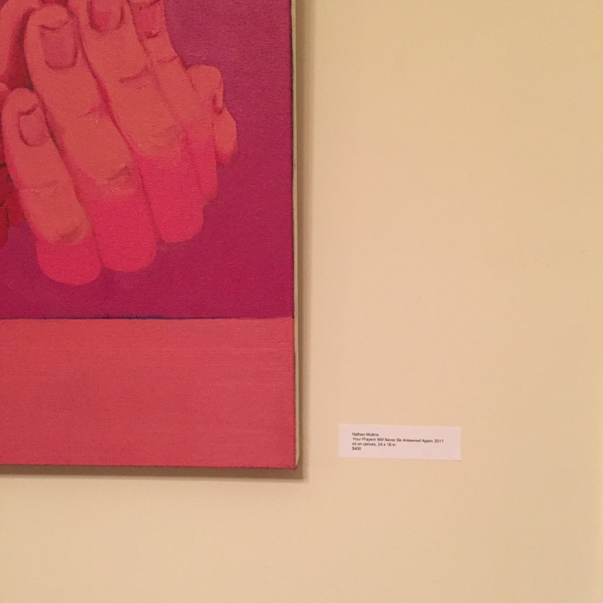 A mobile photo of a portion of Nathan Mullin's portrait of praying hands.