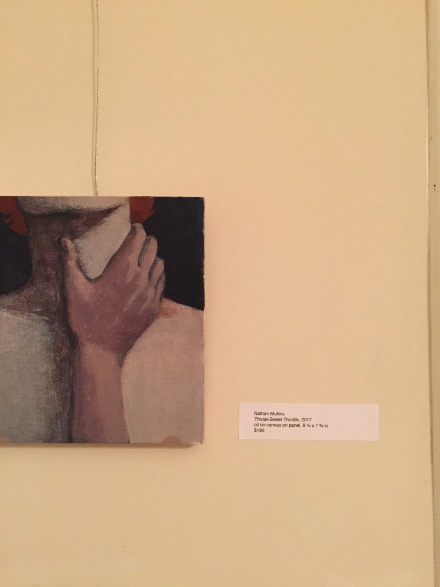 A sensual portrait of a hand caressing a neck.