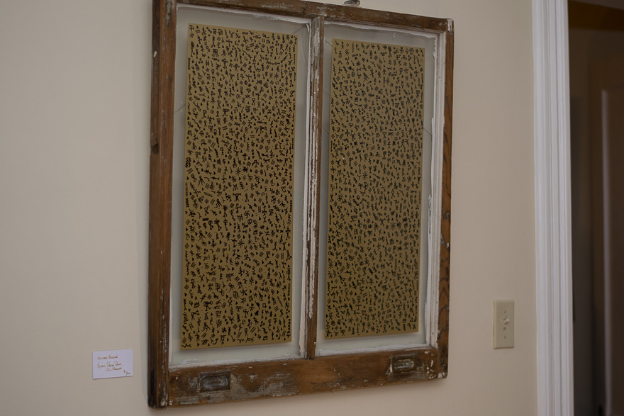 Thomas placed his asemic drawings into an old window pane.