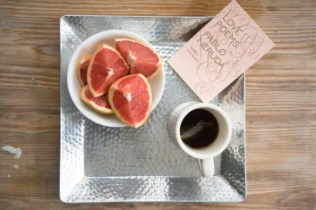 Grapefruit slices, tea, and a Pablo Neruda book of poems for Valentine's Day.