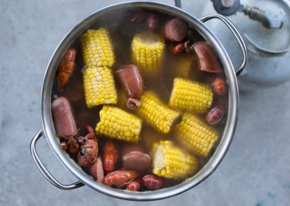 Seafood boil with sausage, corn, and shrimp.