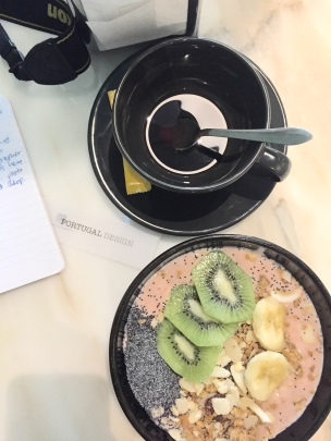 Yogurt fruit bowl with a small American coffee.