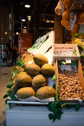 Melons and pecans on display at San Miguel Market in Madrid, Spain.