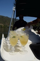 A spritzer is prepared on a small boat ride in Portugal's Douro River Valley.