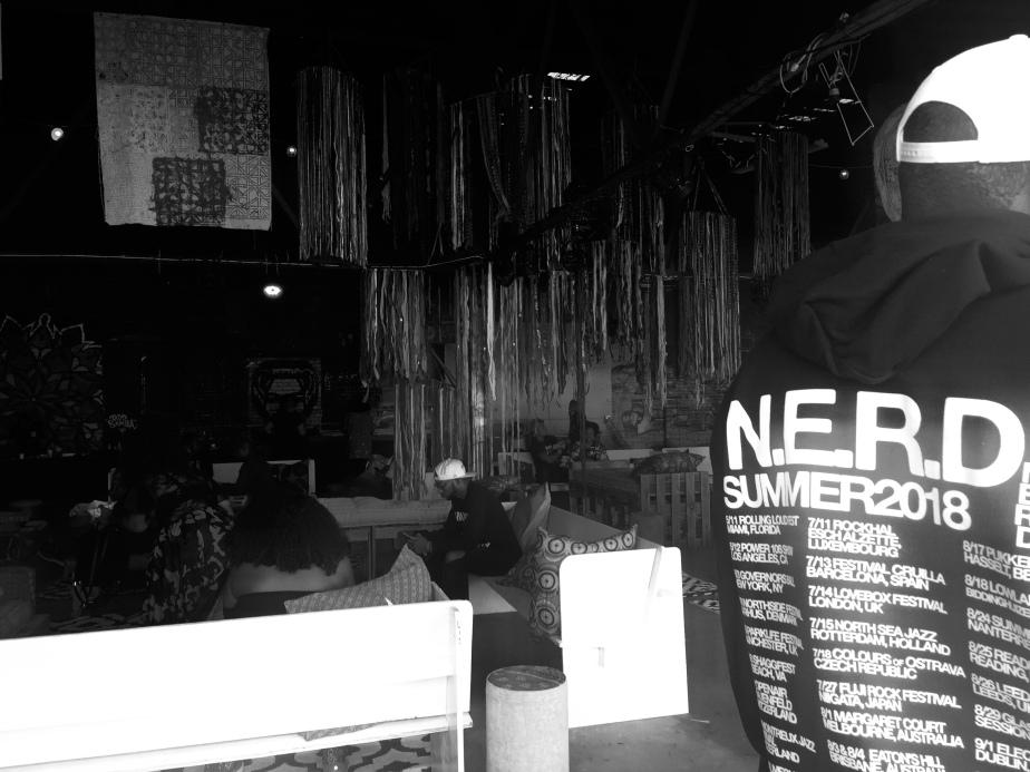 A photo of the back of a man's hoodie with N.E.R.D's Summer 2018 concert tours.