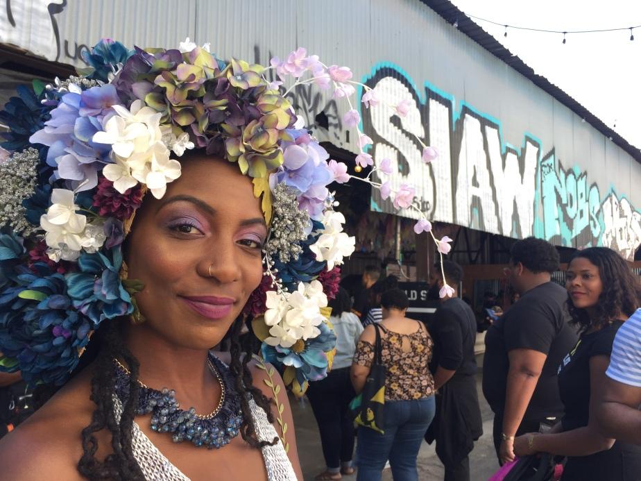 A woman wears a crown of flowers.