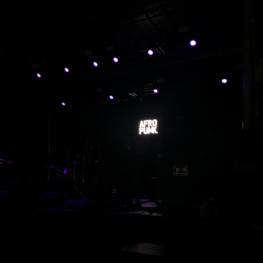 Photo of a dark Afropunk stage.